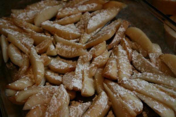 sliced pears sprinkled with flour