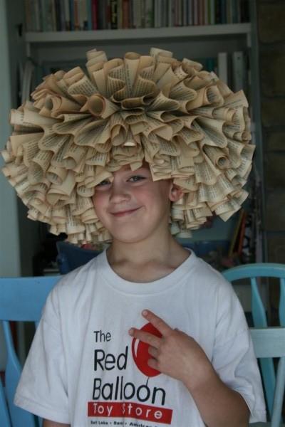 boy wearing book wreath