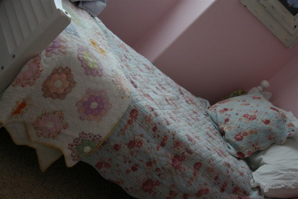 bed with vintage quilt