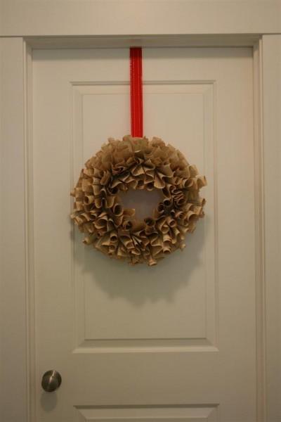 book page wreath hanging on door
