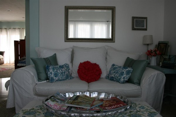 white couch with turquoise and pink pillows
