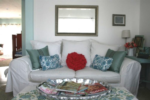 white couch with bright pillows
