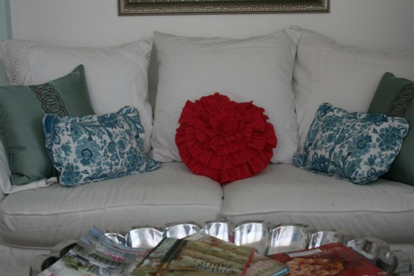 couch with pink and turquoise pillows
