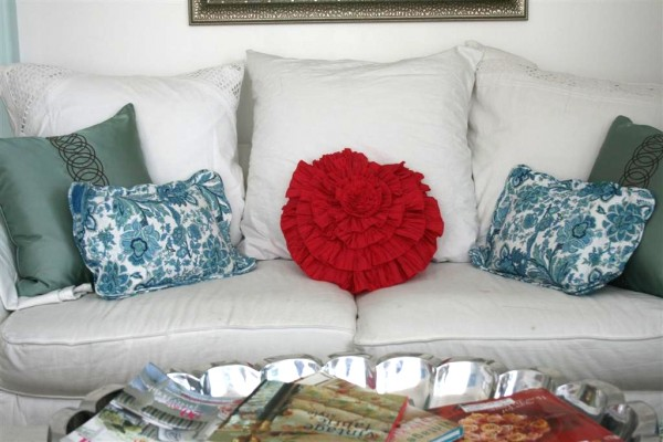 white couch with pillows
