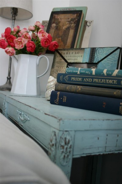 blue tables with books and flowers