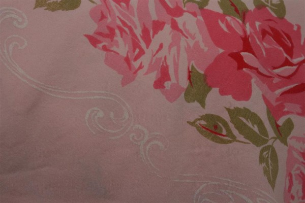 pink roses and white detail on vintage tablecloth