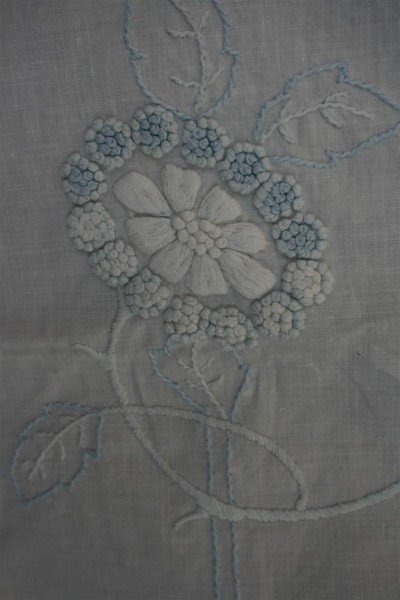 blue and white french knots flower