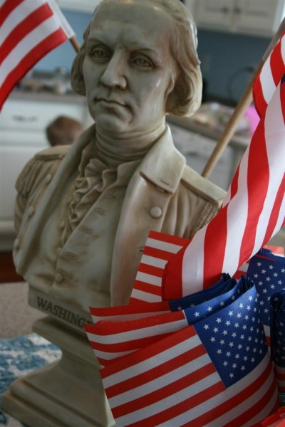 washington bust with flags