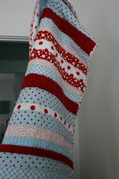 red & aqua strip quilt