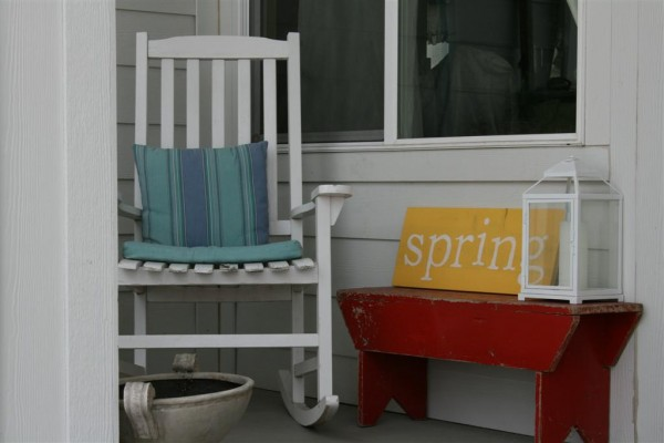 rocking chair with red bench and spring sign