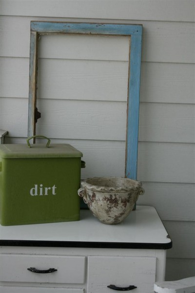 vintage cabinet with dirt bin and window frame