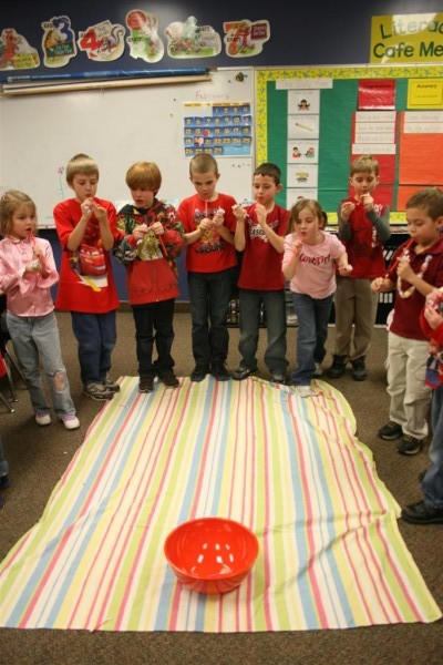 kids playing cupid's arrow game