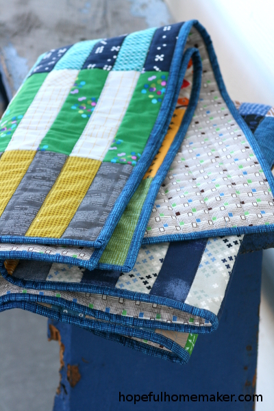 binding on baby color stack quilt by Hopeful Homemaker