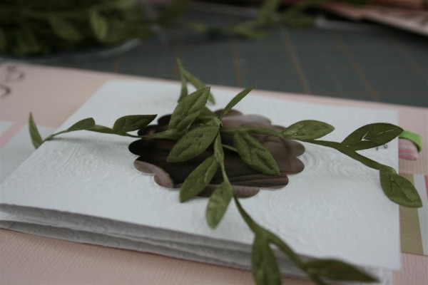 olive leaves tied around paper