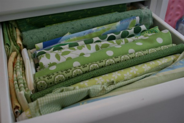 drawer filled with green fabrics