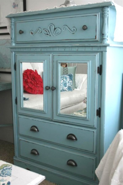 blue dresser with mirrors