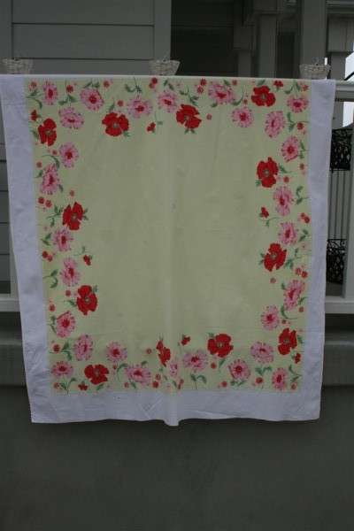vintage yellow tablecloth with pink and red flowers