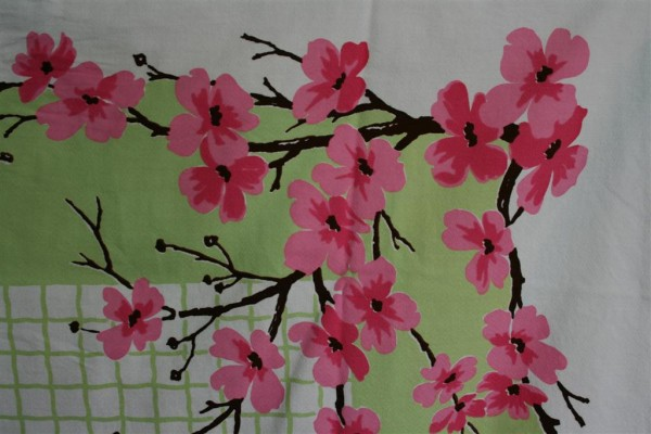 green vintage cloth with pink blossoms
