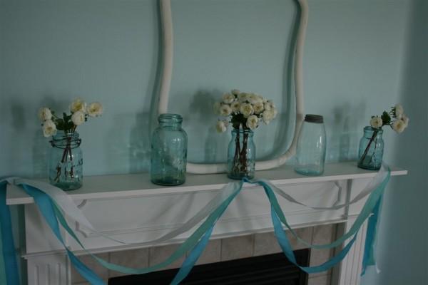 vintage blue jars on mantel