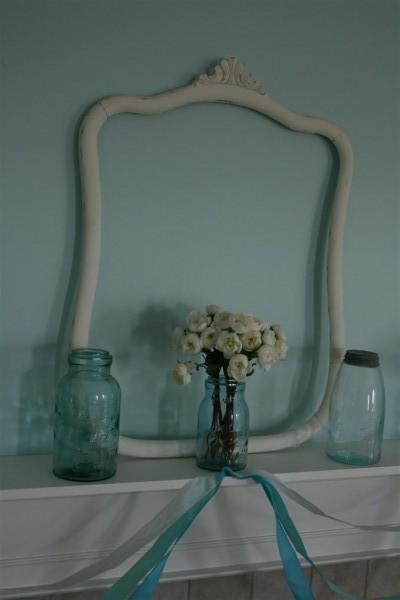 vintage jars and empty frame on mantel