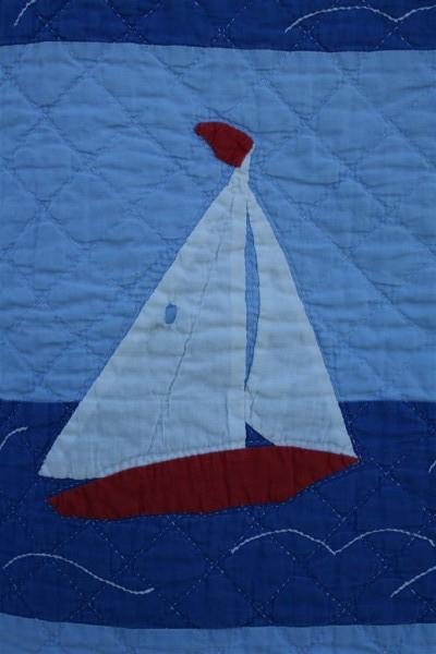 applique sailboats on vintage quilt