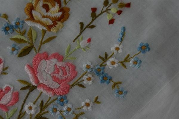 embroidered flowers on vintage handkerchief